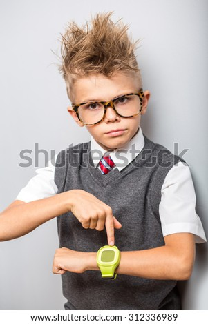 Photo of adorable young happy boy pointing to watches, hurry up concept - stock photo
