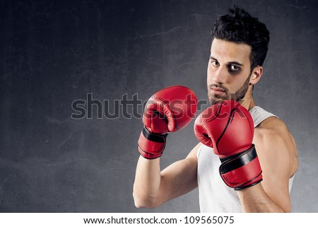 photo of adult boxer background with black eye - stock photo