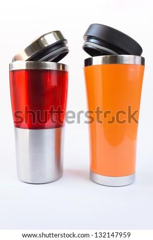 Photo of aluminum  red and orange mug - stock photo