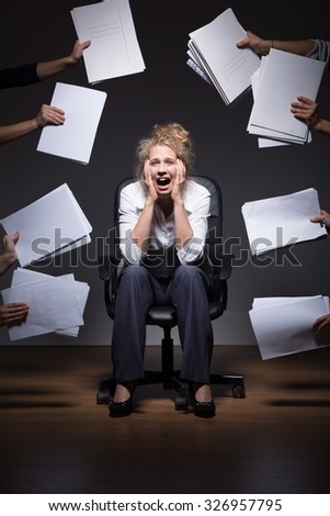 Photo of ambitious trainee overwhelmed by job duties - stock photo