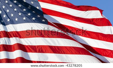 Photo of American flag waving in the wind