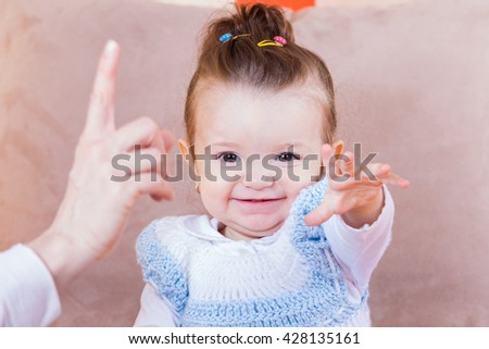 Photo of an adorable cheerful baby girl - stock photo