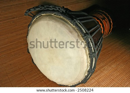 Photo of an african djembe drum on a bamboo background - stock photo