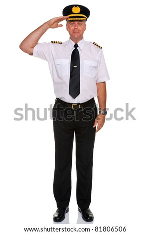 Photo of an airline pilot wearing the four bar Captains epaulettes saluting, isolated on a white background. - stock photo