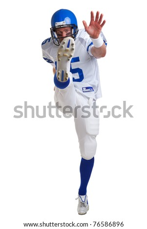 Photo of an American football player kicking, isolated on a white background. - stock photo