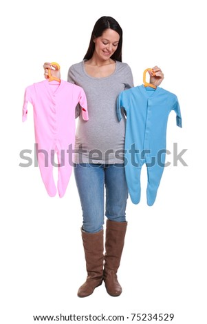 Photo of an attractive brunette woman who is 32 weeks pregnant holding a pink and blue baby grow,isolated on a white background. - stock photo