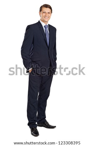 Photo of an attractive businessman smiling with his hands in his pockets.