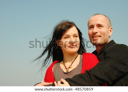 Photo of an attractive hot couple enjoying at the beach - stock photo