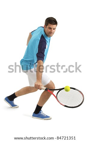 Photo of an attractive male tennis player hitting the tennis ball. - stock photo