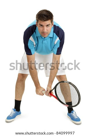Photo of an attractive male tennis player waiting for the serve.  Full body shot with slight shadow around shoes. - stock photo