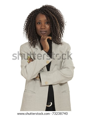 Photo of an attractive young woman standing with her arms folded. White Background - stock photo