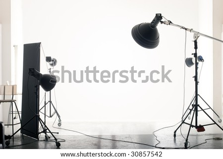 Photo of an empty photographic studio with modern lighting equipment. Empty space for your text or objects.