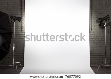 Photo of an empty white background in photographic studio with modern lighting equipment. Empty space for your text or objects - stock photo
