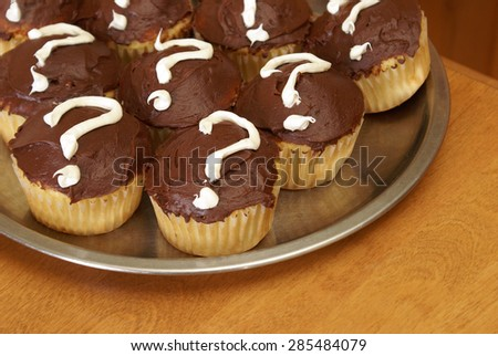 Photo 2 of an event held in revealing the gender of a new mothers baby done in a unique photo series using mystery cupcakes to let people know if its a boy or girl.  - stock photo