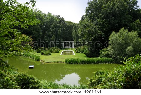 Photo of an Exotic Garden With a Pond, Pool and Greek Structures