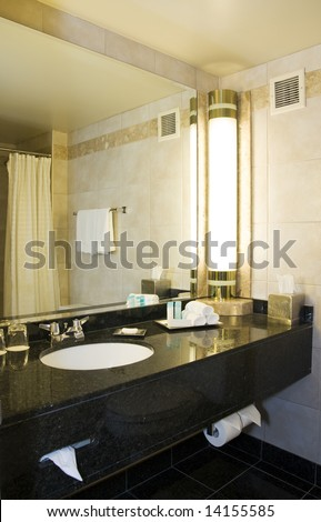 Photo of an hotel bathroom at night