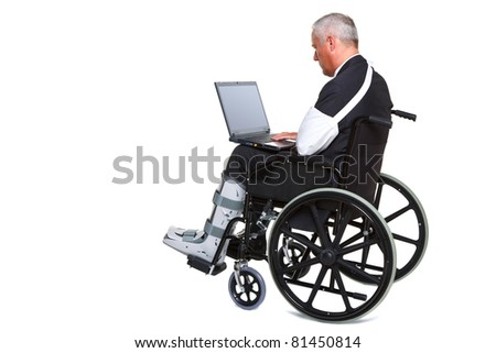 Photo of an injured businessman sitting in a wheelchair working on a laptop computer, isolated against a white background. Laptop screen has a clipping path to add your own message or image. - stock photo