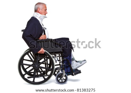 Photo of an injured man pushing himself along in his wheelchair, isolated on a white background. - stock photo