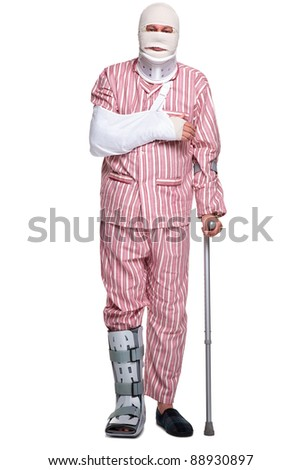 Photo of an injured man walking on crutches, isolated on a white background. - stock photo