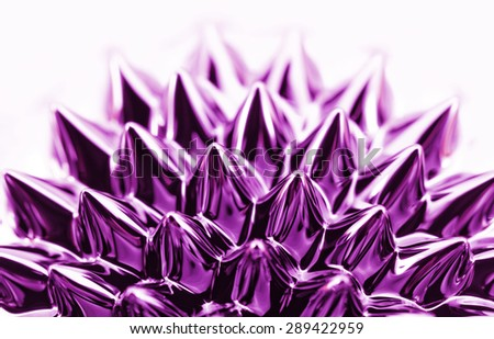 Photo of an interesting, colorful chemical ferrofluid - stock photo