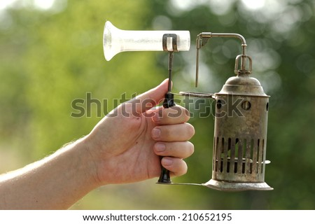 Photo of an old antique inhaler and a man - stock photo