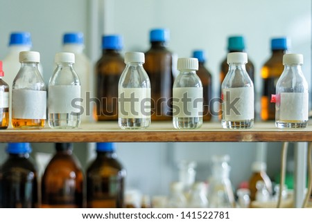 Photo of an old laboratory with a lot of bottles and dirt - stock photo
