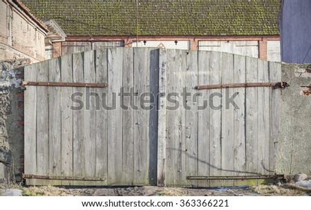 Photo of an old wooden farm gate.
