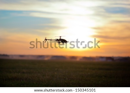 Photo of an RC copter flying at sunset - stock photo