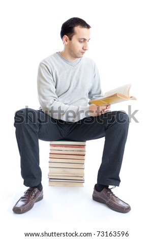 Photo of an young man reading a book on white background