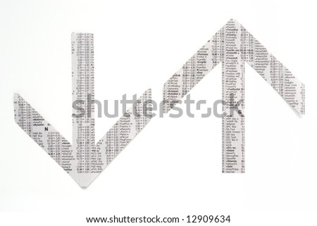 Photo of arrows cut out of a stock market table, dollar, money, business