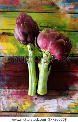 Photo of artichokes on wooden background - stock photo