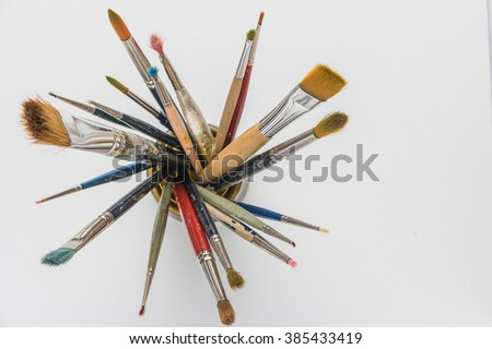 Photo of artist paint brushes in a jar. Top view with copy space. - stock photo