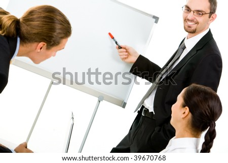 Photo of attentive business partners listening to smart teacher presenting new project - stock photo