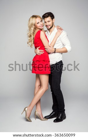 Photo of attractive couple hugging each at other