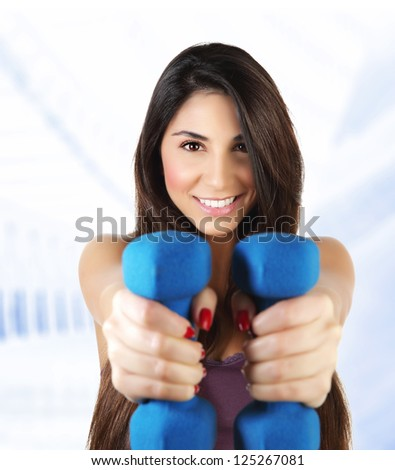 Photo of attractive sporty woman lifting dumbbell, active female doing fitness exercise indoor, isolated on white background, healthy lifestyle, training and loss weight, sport gym, health and beauty - stock photo