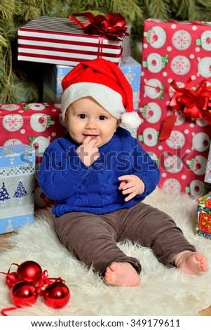 photo of baby in Christmas decorations