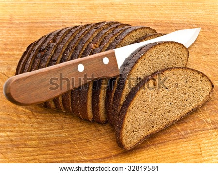 Photo of background the slice bread and  knife at wooden broad