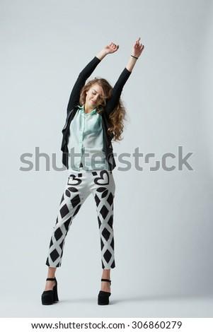 photo of beautiful brunette girl dancing studio shot - stock photo