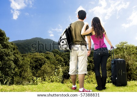 photo of beautiful Couple looking afar from the top of a mountain
