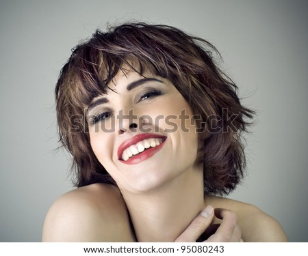 Photo of beautiful laughing woman with short hair - stock photo