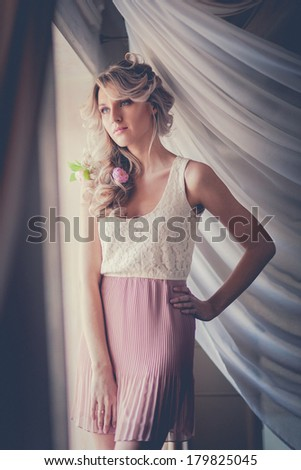 Photo of beautiful sensual woman in romantic pink dress. Photo processed instagram style. - stock photo