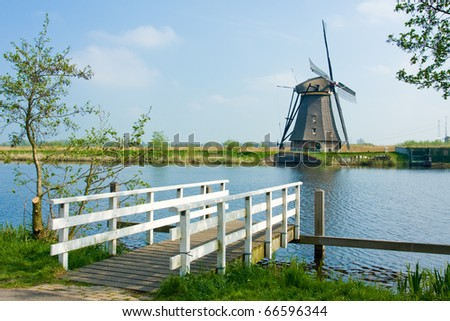 Photo of beautiful windmill in Kinderdijk - Holland - stock photo