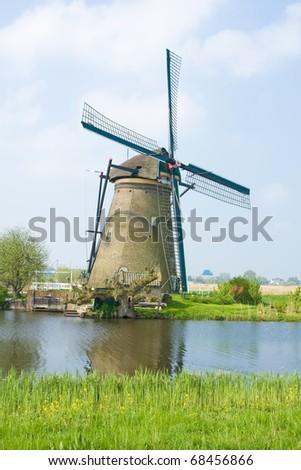 Photo of beautiful windmill in Kinderdijk - Holland - stock photo