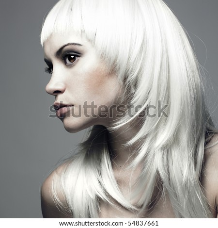 Photo of beautiful woman with blond hair - stock photo
