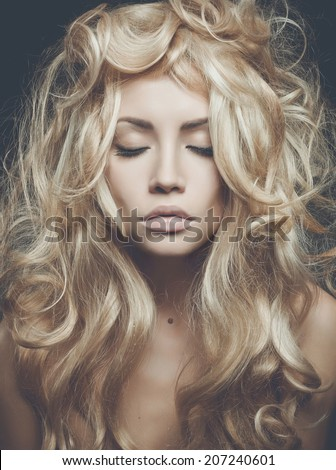 Photo of beautiful woman with magnificent blond hair. Blond Hair, Hair Extension, Permed Hair - stock photo