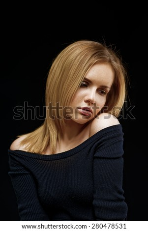 Photo of beautiful woman with magnificent eyes on black background - stock photo