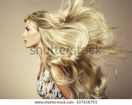 Photo of beautiful woman with magnificent hair. Fashion photo - stock photo