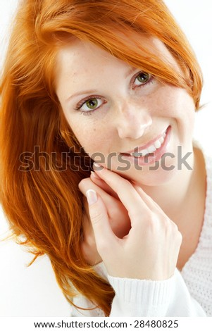 Photo of beautiful woman with red hair and freckled skin on her face - stock photo