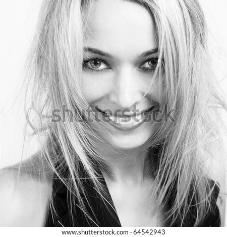 Photo of beautiful young woman with blond hair - stock photo