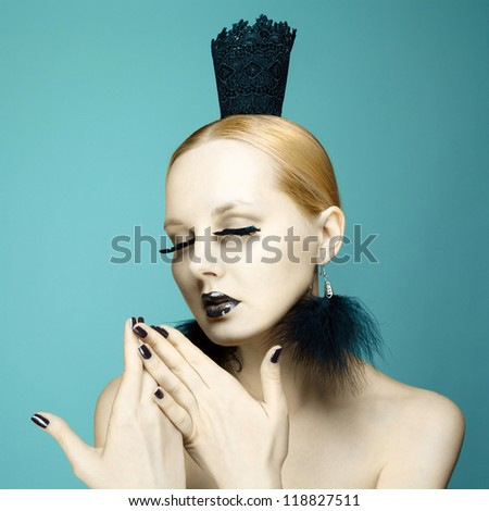 Photo of beautiful young woman with magnificent eyelashes.  Fashion portrait of queen